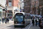 photo of a Nottingham Express Transit tram running on-street